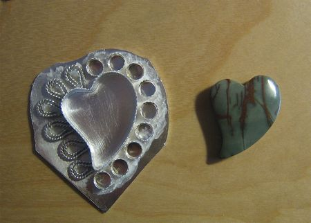 Heart setting in process with stone