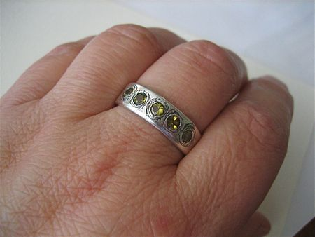 Peridot ring on hand